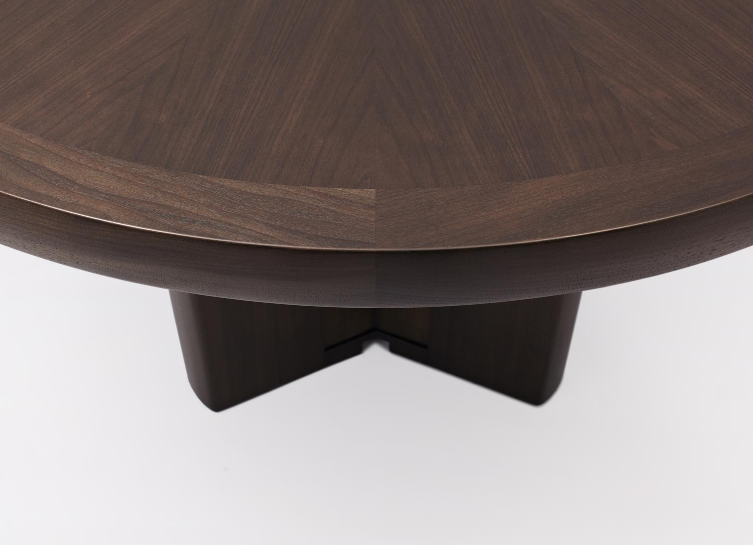 0d9be4d99892 Round pedestal dining table with four (4) legs. Base made of solid walnut.  Top has solid walnut edges and starburst veneer pattern.